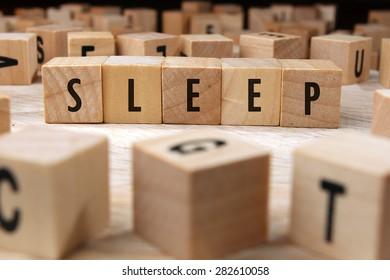 sleep word written on wood block