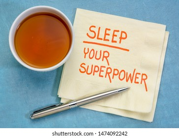Sleep, your superpower concept - handwriting on a napkin with a cup of tea