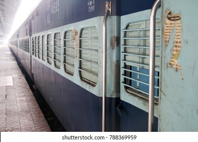 A Sleeper class coach at a train station in India. A cheap way to travel by across the country.
