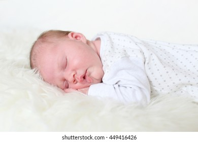 Sleeping 3-weeks newborn girl