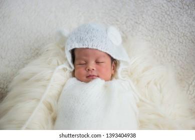 Sleeping  asian Newborn baby on blanket