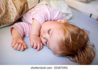 Sleeping baby girl in bed