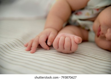Sleeping baby with hands together