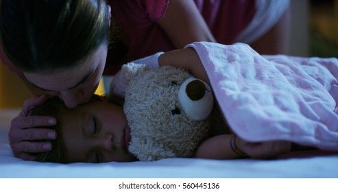 sleeping baby happy and carefree, the mother caresses kiss goodnight. concept of house and home. night and happy dreams, no mosquitoes, no noisy home and comfortable mattresses. comfortable children