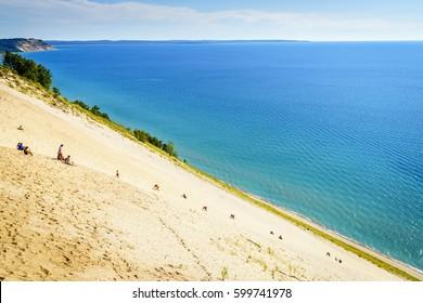 Sleeping Bear Dunes, August 8, 2016: People climbing steep sand dune in Sleeping Bear Dunes National Lakeshore, Michigan