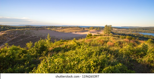 Sleeping Bear Dunes Panorama. View from an overlook of massive sand dunes at the famous Sleeping Bear Dunes National Lakeshore in Michigan.