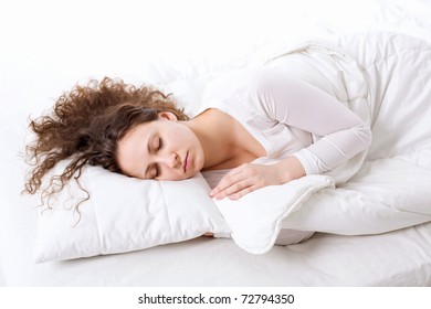 Sleeping beautiful curly woman