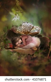 Sleeping beauty fairy in autun leaf