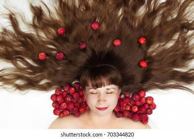 sleeping beauty with long hair and apples top view