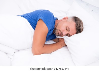 Sleeping beauty. Man handsome guy lay in bed. Get enough amount of sleep every night. Tips sleeping better. Bearded man sleeping face relaxing on pillow. Pleasant relaxation concept. Perfect rest.