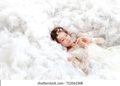 sleeping beauty princess / beautiful asian bride sleeping on white cotton wool