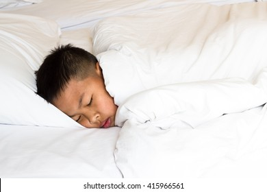 The sleeping boy ,Young asian boy sleeping in bed