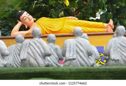 Sleeping buddha and his follower statues on the wesak procession floats vehicle during wesak day,  29th May 2018 at Maha Vihara Buddhist temple, Brickfields, Malaysia.