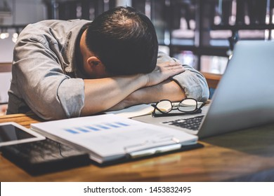 Sleeping Businessman, Tired senior businessman sleeping having long working day overworked on table in his office.