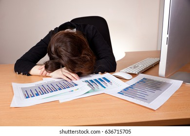 Sleeping businesswoman with financial report at office