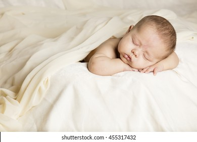 Sleeping caucasian new baby in his  silky bed