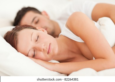 Sleeping couple lying in their bed in the bedroom