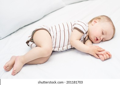 sleeping  funny baby boy on a white background