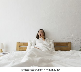 Sleeping girl on the bed in the morning bedroom.