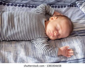 sleeping happy newborn babe close up, selective focus