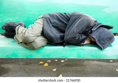 sleeping homeless man on the bench