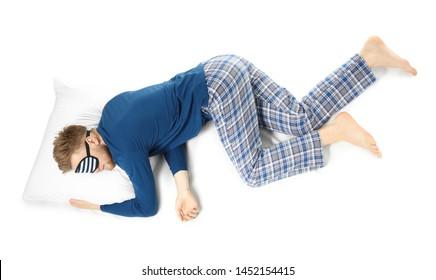 Sleeping man with mask on white background