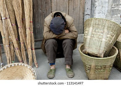 sleeping man and traditional hand tools