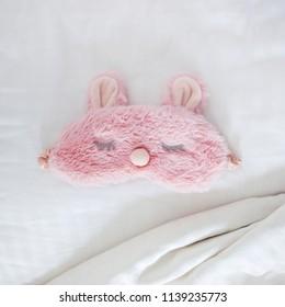 Sleeping mask on the bed. Healthy sleep, accessories