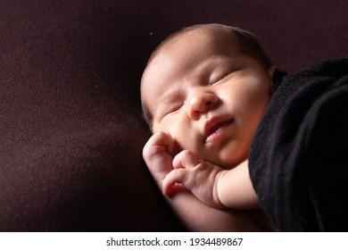 sleeping mixed race baby boy