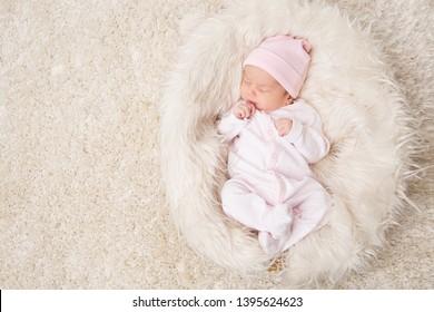 Sleeping New Born Baby, Newborn Kid Sleep on White Fur, Beautiful Infant Studio Portrait, One month old