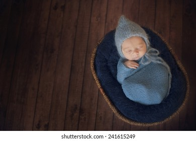 Sleeping Newborn Baby in Basket