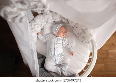 sleeping newborn baby in the crib