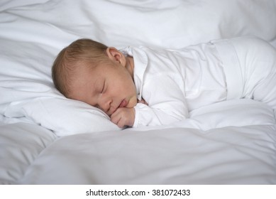 Sleeping newborn baby girl (only has 12 days from birth)