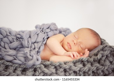 Sleeping newborn baby. Infant lovely covered with blanket. The child can be boy or girl.