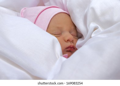 sleeping newborn baby, only a five-day age