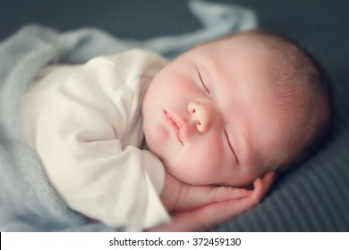 sleeping newborn baby in a wrap