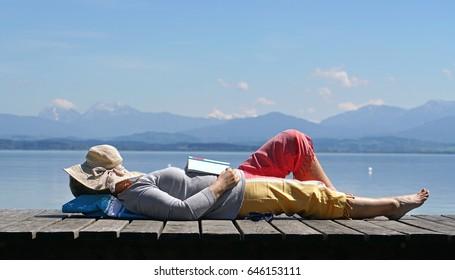 sleeping Senior woman, Senior woman with hat enjoy her vacation at lake