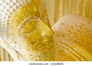 Sleeping white Buddha statue with gold leaf  in Thailand