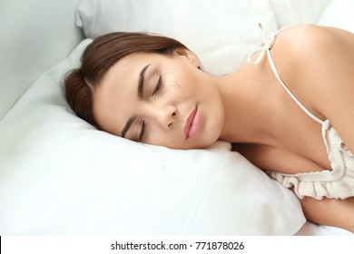 Sleeping woman and artificial eyelashes on pillow