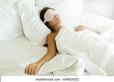 Sleeping woman with eye mask  in the bedroom