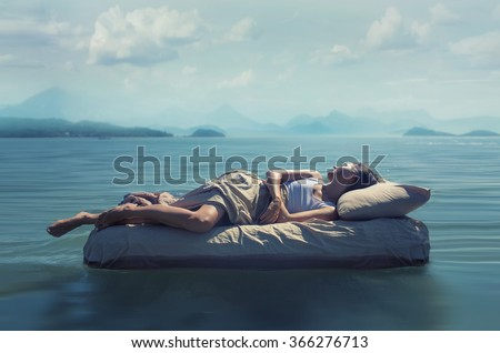 Sleeping woman lies on airbed in water.