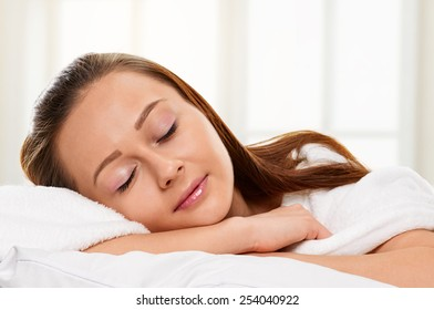 Sleeping young beauty girl about the window
