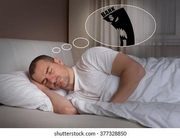 Sleeping young man having a bad dream - bank and mortgage