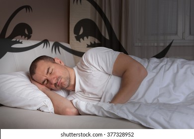 Sleeping young man having a bad nightmare