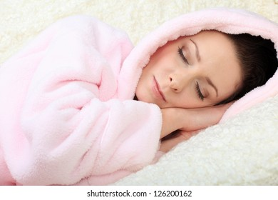 Sleeping young woman having her eyes closed