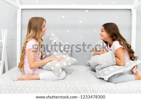 888bde3853 Sleepover party ideas. Girls happy best friends or siblings in cute stylish  pajamas with pillows