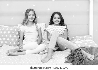 Sleepover time for fun gossip story. Best friends forever. Soulmates girls having fun bedroom interior. Childhood friendship concept. Girls best friends sleepover domestic party. Girlish leisure.