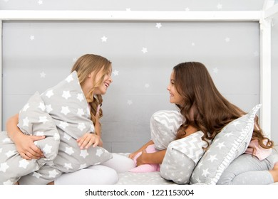 Sleepover time for pillow fight. Girls sleepover party ideas. Soulmates girls having fun sleepover party. Girls happy best friends in pajamas with pillows sleepover party. Pillow fight pajama party.
