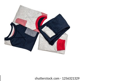 Sleepwear set on white background. Shirt and pants made of gray/red/blue cotton fabric. Pajama for boy. Flat lay. Top view.