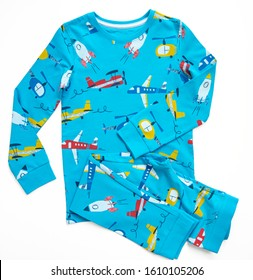 Sleepwear set for a toddler boy on white background. Shirt and pants made of blue pattern cotton fabric. Pajama for boy. Flat lay. Top view.